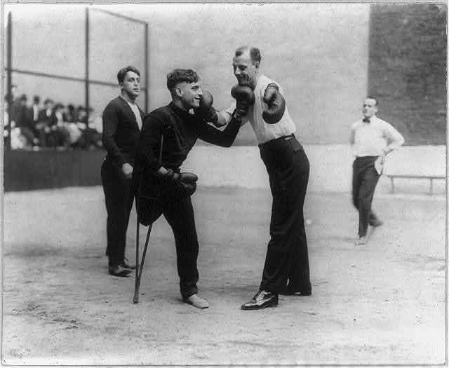 Sam Luzofsky (one leg) and Lon Young (one arm) boxing