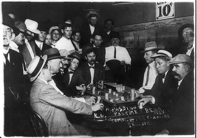 [Scenes of open gambling in Reno, Nevada casinos: game of faro; many spectators]