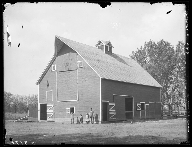 Several children standing in front of Woolman barn south of Shelton, on an island,.