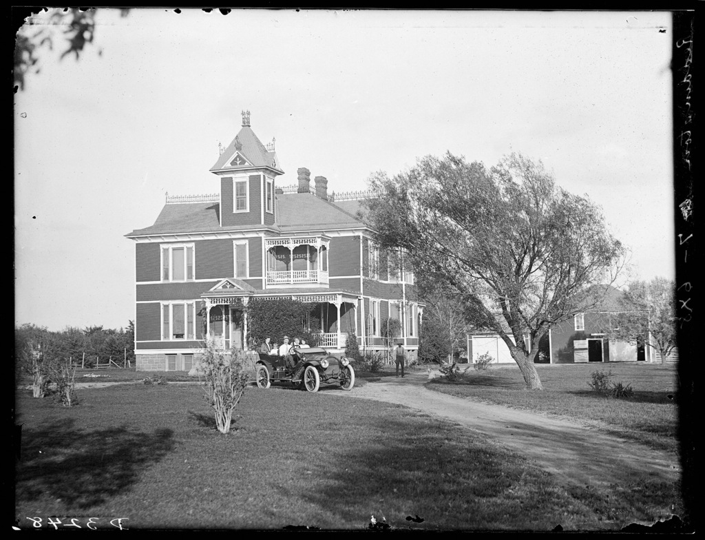 Several seated in automobile in front of Meisner ranch home, Shelton vicinity, Buffalo County, Nebraska