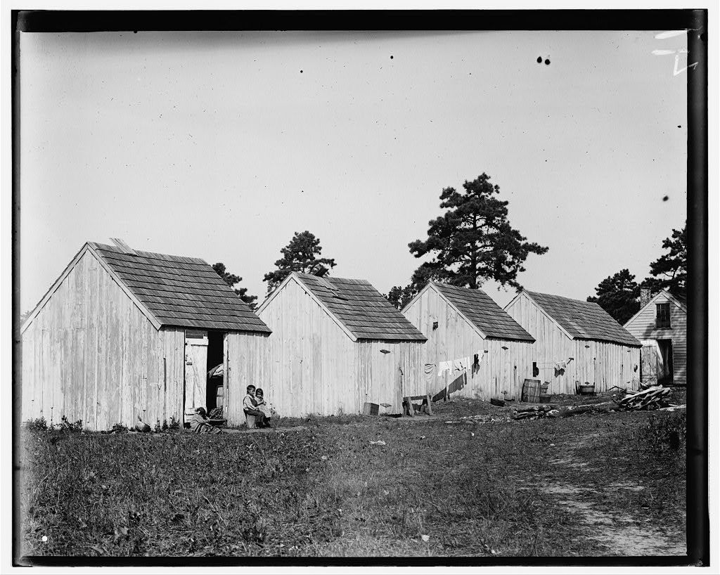 [Small shack on Forsythe's Bog, occupied by De Marco family, 10 in the family living in this one room. Room is 10 ft. x 11 ft. x 5 1/2 ft. high and gable attic above. Wooden toilets near at hand and bushes used as such, gave forth offensive odors. Turkeytown, near Pemberton, N.J. E.F. Brown Witness. See family picking cranberries in photo #1151.]  Location: Pemberton, New Jersey.
