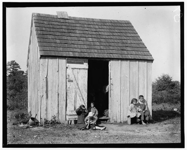 Small shack on Forsythe's Bog, occupied by De Marco family, 10 in the family living in this one room. Room is 10 ft. x 11 ft. x 5 1/2 ft. high and gable attic above. (See family picking cranberries in photo #1151.) Wooden toilets near at hand and bushes used as such, gave forth offensive odors. Turkeytown, near Pemberton, N.J. E.F. Brown Witness.  Location: Pemberton, New Jersey.