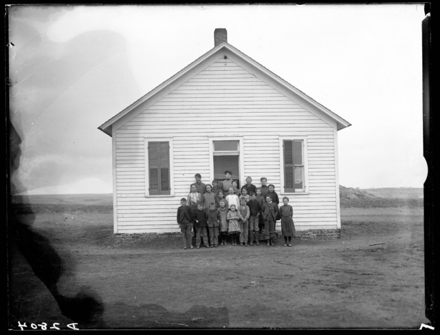 Students and their teacher in front of schoolhouse north of Kearney, Nebraska