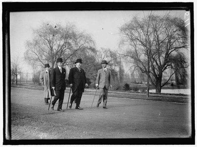 TAFT, WILLIAM HOWARD. OUT FOR A STROLL WITH ARCHIBALD BUTT, MILITARY AIDE, AND CHARLES DEWEY HILLES, SECRETARY TO THE PRESIDENT