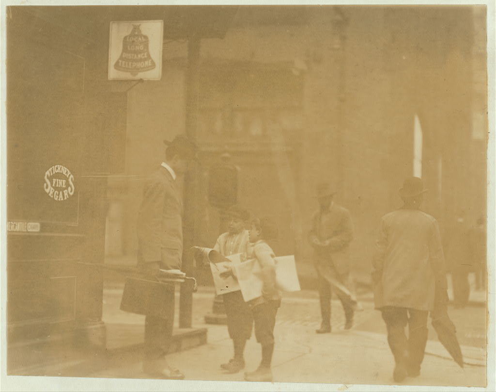 Team work. Older brother makes smaller boy do the work. Small boy said he was 9 years old. Appears to be 7. May 7th, 1910. Witness E.N. Clopper.  Location: St. Louis, Missouri.