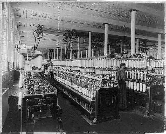 Textile factory with two women at machines