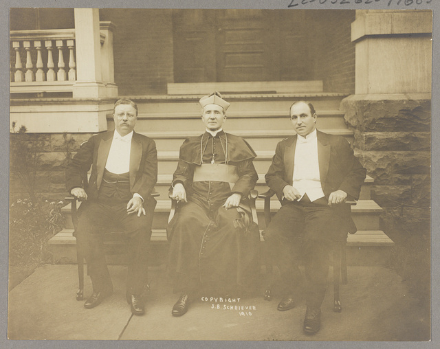 [Theodore Roosevelt, Rev. M.J. Hoben [i.e. Hoban], and John Mitchell, posed, seated in front of porch]
