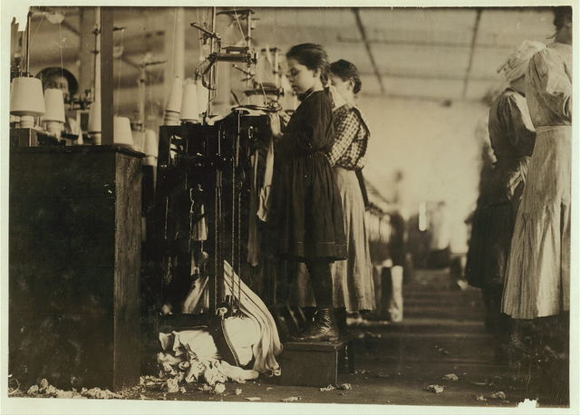 This little girl like many others in this state is so small she has to stand on a box to reach her machine. She is regularly employed as a knitter in London [i.e., Loudon?] Hosiery Mills. Said she did not know how long she had worked there. (See other photos and report.)  Location: Loudon, Tennessee.