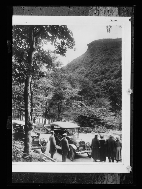 [Tourists gazing at Old Man of the Mountain, White Mountains, N.H.]