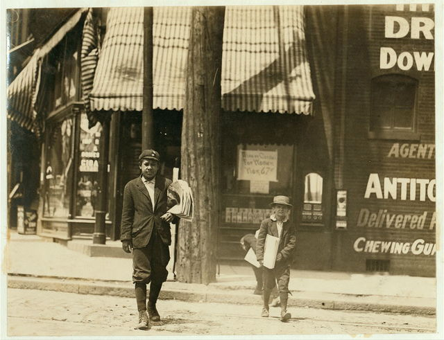 "Truants selling papers at Jefferson and Washington 11 A.M. Monday, May 9th, 1910. Smallest boy is Marvin Adams, 2637 Washington Ave. Said he got his papers ""off'n de other feller.""  Location: St. Louis, Missouri."