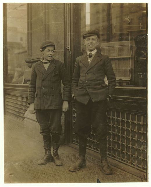 "Two ""brothers,"" errand boys, employed in Dey Bros. & Co, Dept. Store. Salina & Jefferson Streets. 11 A.M.  Location: Syracuse, New York (State)"