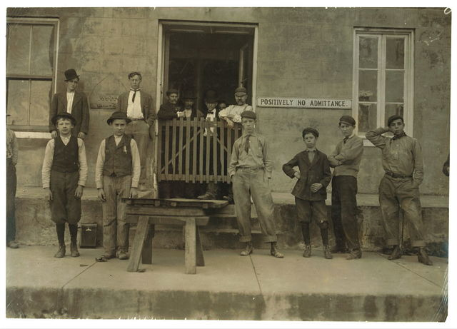 """Two of the Boys Working in Phoenix American Cob Pipe Factory, Washington, Mo. Smallest boy is Joe Krummel. See sign, """"Wanted--Men and Boys."""" Around corner was a sign, """"Girls Wanted."""" Couldn't get any photos of girls.  Location: Washington, Missouri."""