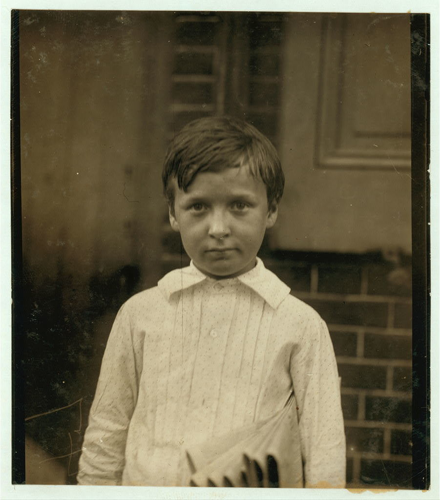 Walter Ray, 400 Walnut St. 8 years of age. Selling papers 1 year. Average earnings 35 cents per week. Selling papers own choice. Don't smoke. Earnings not needed at home. Visits saloons. Works 5 hours per day. Investigator, Edward F. Brown.  Location: Wilmington, Delaware / Photo by Lewis W. Hine., May, 1910.
