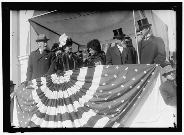 [Woodrow Wilson and wife Ellen with unidentified on viewing stand]