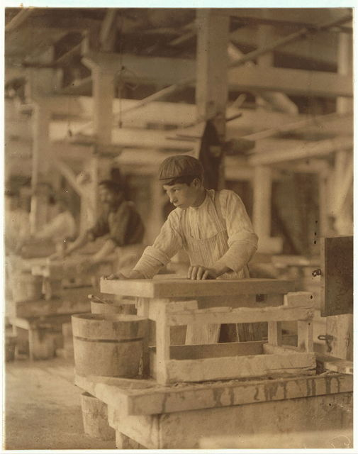 Young boy polishing marble in Vermont Marble Co., Centre Rutland, Vt. Most of these are illiterates.  Location: Centre Rutland, Vermont.