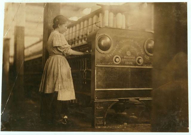 Young girl working in Anniston Yarn Mills.  Location: Anniston, Alabama.