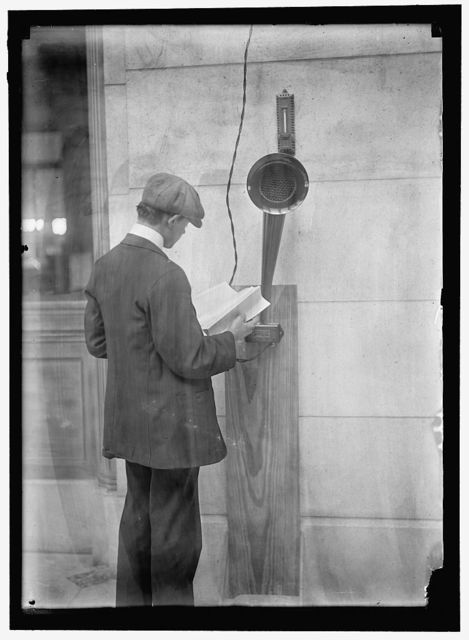 [Young man standing near speaker]