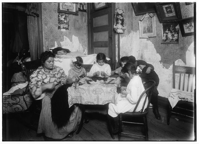 5 P.M. Mrs. Mary Mauro, 309 E. 110th St., 2nd floor. Family work on feathers. Make $2.25 a week. In vacation 2 or 3 times as much. Victoria, 8 yrs. Angelina 10 yrs. (a neighbor). Frorandi 10 yrs. Maggie 11 yrs. All work except two boys against wall. Father is street cleaner and has steady job. Girls work until 7 or 8 P.M. Once Maggie (11 yrs.) worked until 10 P.M.  Location: New York, New York (State)