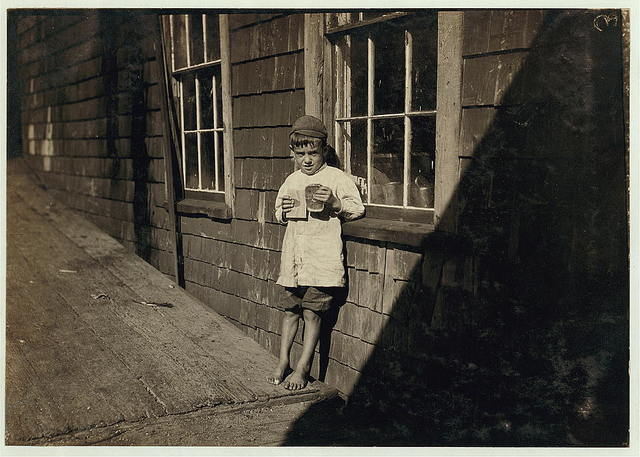5 year old Preston, a young cartoner in a Maine Canning Co. I saw him at work different times during the day - at 7 a.m., in the afternoon and at 6 p.m., and he kept at it very faithfully for so young a worker.  Location: Eastport, Maine.
