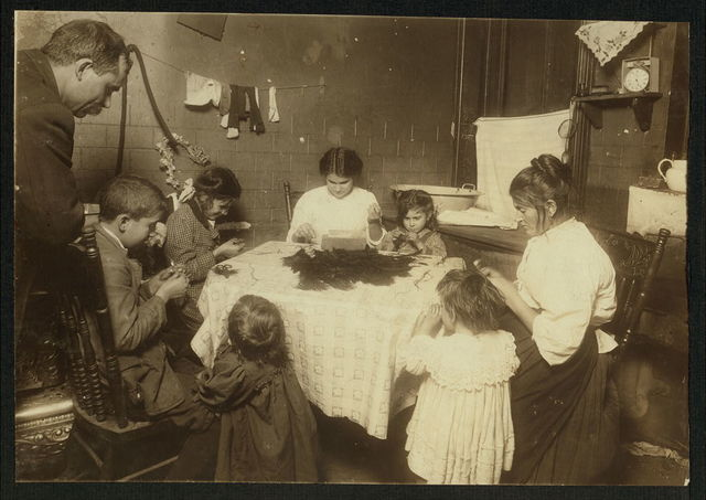 """5:15 P.M. Father hanging around the home while family works on feathers. Said, """"I not work. Got some sickness. Dunno what."""" Mother; Millie, 16 yrs.; Jimmie, 11 yrs.; Mary, 12; Camilla, 5 all work. Some of the children until 9 and 10 P.M. at times. They said """"Camilla, she can tie feathers but she don't want to."""" If all work, they make $4, $5, or even $6 a week. Dirty floor. Vermin abounded. Garbage standing uncovered near the work,.  Location: [New York, New York (State)]."""