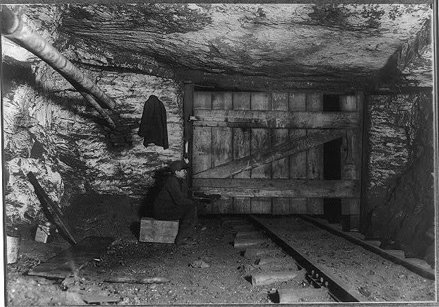 A lonely job. Waiting all alone in the dark for a trip[?] to come through. It was so damp that Willie said he had to go to the doctor for his cough. A short distance from here, the gas was pouring into the mine so rapidly that it made a great torch when the foreman lit it. Lives at 164 Center St., Pittston, Pa. This is Willie Bryden[?], a nipper. Been working there 4 mos. 500 ft. from the shaft, and a quarter of a mile underground from there. Shaft #6 Pa. Coal Co. Walls have been whiterewashed to make it lighter. Jan 16 I found Willie at home sick, His mother admitted he is only 13 yrs old; will be 14 next July. She said 4 months after the mine boss told the father to take Willie to work, and they obtained a certificate from Squire Barrett. The only thing the squire could do was to make Willie out to be 16 yrs. Willie's father & brother are miners and the home is that of a frugal German family.  Location: Pittston, Pennsylvania.
