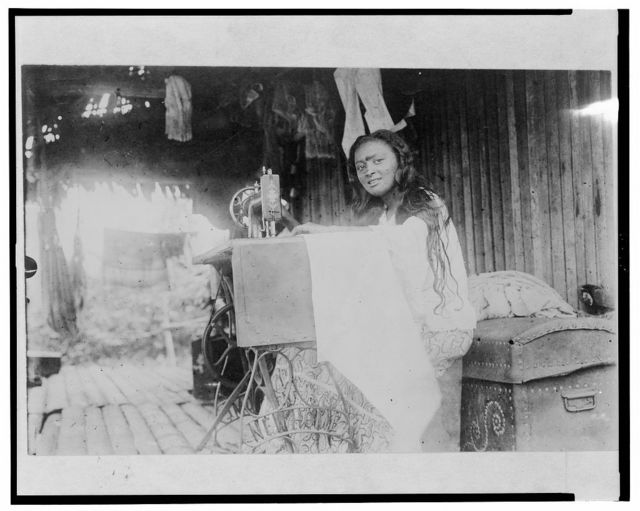 """A """"New Home"""" sewing machine in an Indian dwelling / Algot Lange, New York, N.Y."""