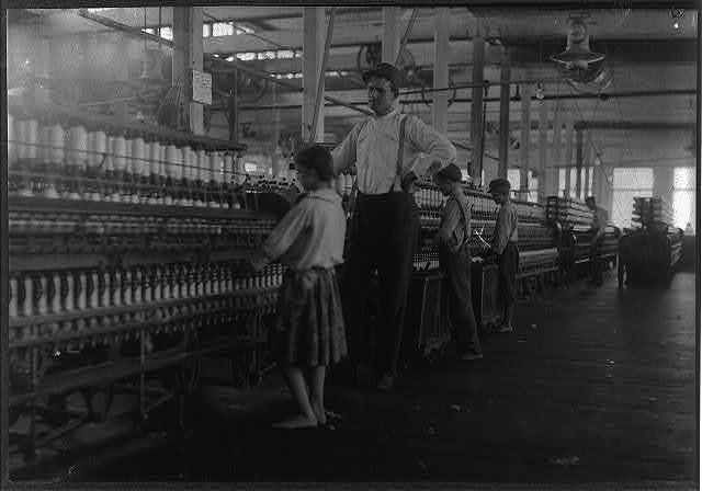 A young spinner in Yazoo City (Miss) Yarn Mills. Said he was thirteen, but doubtful.  Location: Yazoo City, Mississippi.