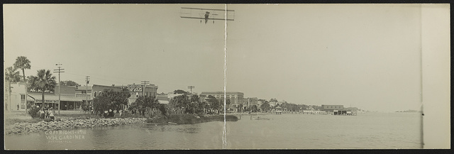 [Airplane flying over water, Daytona, Florida]