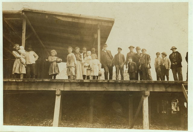 All these children were shucking oysters and tending babies at the Pass Christian Company. (Dunbar, Lopez, Dukate Co.) before daybreak and until about 5 P.M. Photos taken at noon in absence of Supt., who permits no photos on account of Child Labor agitation.  Location: Pass Christian, Mississippi.