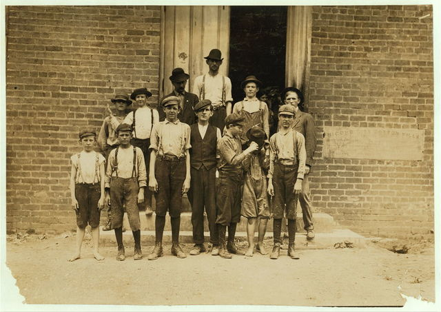 All work in Delta Cotton Mills, Mc Comb Miss. Smallest boy, a band-boy, is Johnnie Mathews, apparently only ten or eleven, but his mother assured me he is nearly fourteen, which is very doubtful. Been working one year. Couldn't write his name. Next to him is Charlie Davis, a sweeper, seemed to be eleven, but mother told me twelve. Has been working a long time. Father and two brothers in the mill. They own their home. Other boys working there: Arthur Littelson, Harvey Green, Lee Kelley.  Location: McComb, Mississippi.