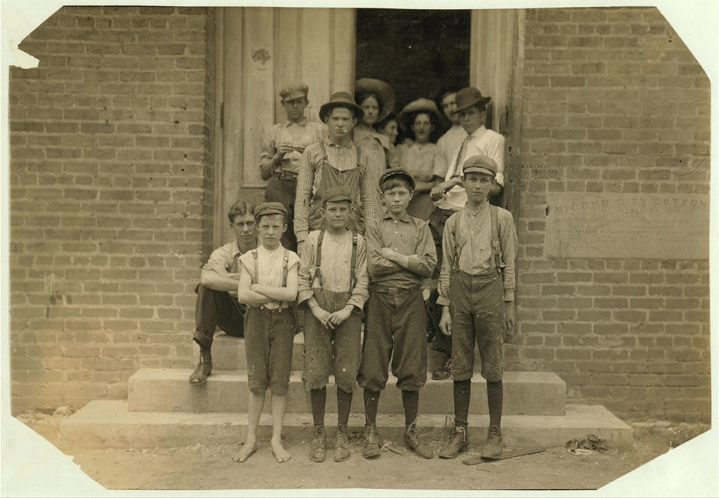 All work in Delta Cotton Mills, Mc Comb, Miss. Smallest boy, a band boy, is Johnnie Mathews, apparently only ten or eleven, but his mother assured me that he is nearly fourteen, which is very doubtful. Been working one year. Couldn't write his name. Next to him is Charlie Davis, a sweeper, seemed to be eleven but his mother told me twelve. Has been working a long time. Father and two brothers in the mill. They own their home. Other boys working there: Arthur Littleton, Harvey Green, Lee Kelley.  Location: McComb, Mississippi.