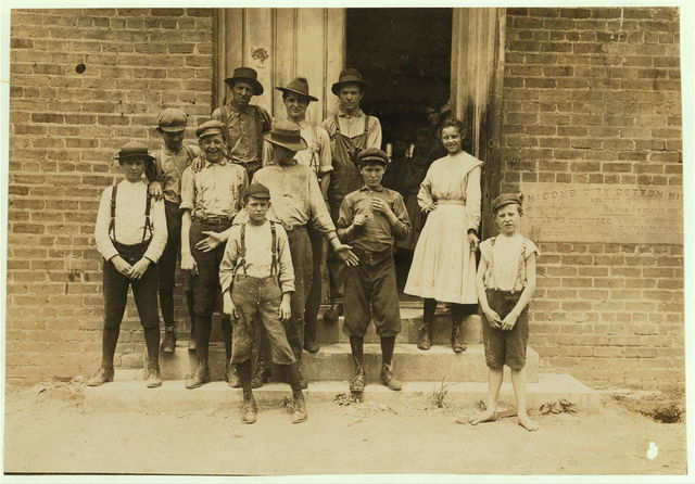 All work in Delta Cotton Mills, Mc Comb, Miss. Smallest boy, a band boy, Johnnie Mathews, apparently only ten or eleven, but his mother assured me he is nearly fourteen, which is very doubtful. Been working one year. Couldn't write his name. Next to him is Charlie Davis, a sweeper, seemed to be eleven, but mother told me twelve. Has been working a long time. Father and two brothers in the mill. They own their home. Other boys working there: Arthur Littleton, Harvey Green, Lee Kelley.  Location: McComb, Mississippi.