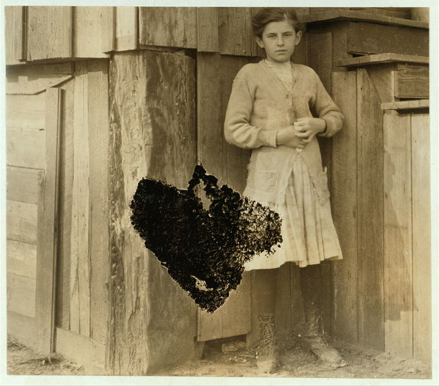 Annie Puchs[?], eleven years old. Been shucking four years. Picked berries in Delaware last summer. Said she'd rather pick than shuck. Does housework too. She is in factory photos taken that morning.  Location: Bayou La Batre, Alabama.