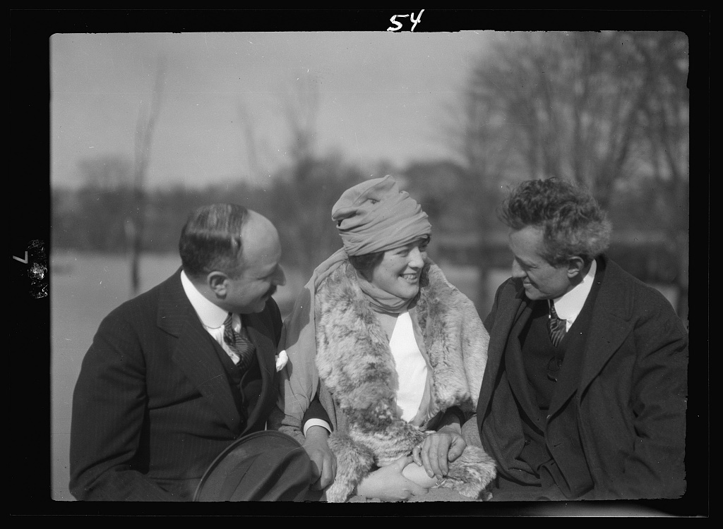 Arnold Genthe seated outdoors with two friends
