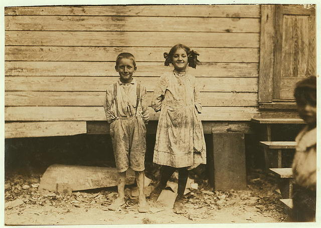 Carrie Dietrick, ten years old. Raymond, seven years old. Pick shrimp at the Peerless Oyster Co.  Location: Bay St. Louis, Mississippi.