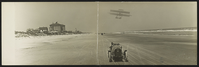 [Cars on beach with airplane overhead and Clarendon Hotel in background, Seabreeze, Daytona Beach, Florida]