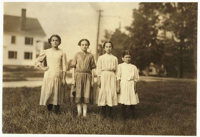 Comparison of ages: On right end is Mary Deschene, admitted 11 years, helped sister spool all summer in Glenallen Mill. Next her is Lumina Demarais, admitted 12 years, and doffing all summer in Spring Village Mill. Next is Rosina Coyette, said she was 14 but Mr. Hine doubted it; has steady job doffing and spinning in Spring Village Mill. Left end is Eva Caonette, spinner in Spring Village Mall, said she was 14 but may not be.  Location: Winchendon, Massachusetts.