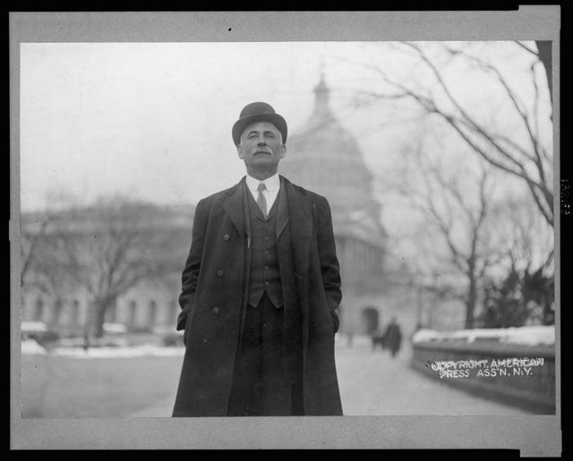 [Congressman Dorsey W. Shackelford, three-quarter length portrait, standing, facing front, Capitol building in background]