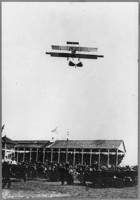 Curtiss biplane [in flight] at Northern Wisconsin State Fair