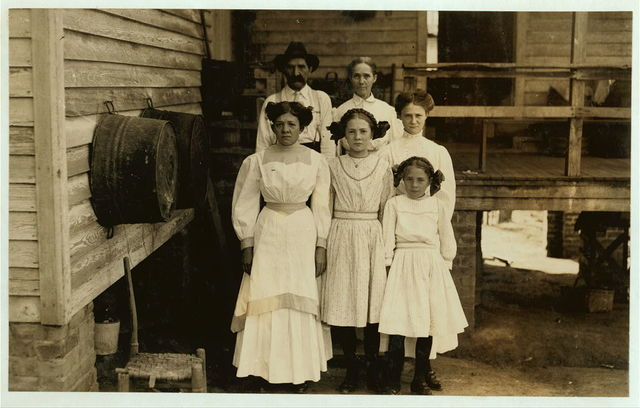"""Dependent (able-bodied) Parents. Fries, Va. Family of Albert Senter. He said, """"I don't work steady. Have a garden here."""" Eleven year old Mandy has learned to """"spin"""" by """"helping."""" She said, """"They say I'm too little to work steady."""" Father added, """"I guess she'll get in all right in a little while. They've been extra careful, lately, 'cause the inspector's been around, but it'll be easier now for her to get in."""" The three girls work and Mandy helps, with one eye on a steady job.  Location: Fries, Virginia."""