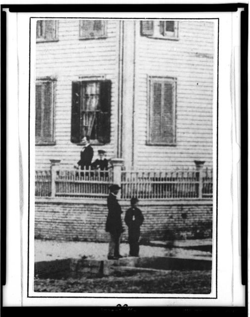 [Detail from photo that shows Abraham Lincoln at home in Springfield, Illinois, standing inside the fence with his son Willie and Tad (looking out from behind the corner post), summer, 1860]