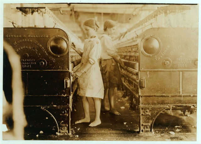 Elsie and Sadie at their machines, Yazoo City (Miss.) Yarn Mills. Both said thirteen years old, but see photo and label 2102.  Location: Yazoo City, Mississippi.