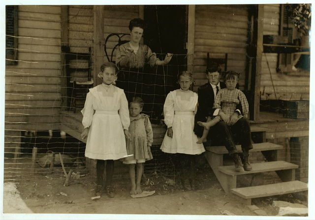 "Family of A.P. Stata (he is at church). Father, son and two oldest girls in photo work in Washington Cotton Mills, Fries, Va. The little spinner on left of photo has been working three years. Runs six sides. Can run eight, ""if they'd let me.""  Location: Fries, Virginia."
