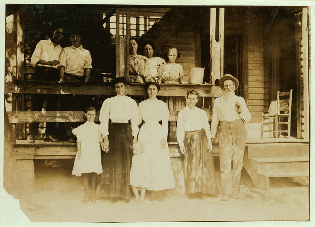 "Family of B. F. Clark, 219 N. 4th Street. This family has worked in 8 different mill villages in the past five years. Clark was a prosperous farmer, before that, but his farm ran down. He says mill families get the habit of moving from place to place. ""And mills are writing all the time, giving great inducements and trying to fool you too."" Some of the families around here have moved much more than we have. Moving eats up a heap of money."" The father and all in group except mother and baby are in the mill. Home bare and ill-kept.  Location: Columbus, Mississippi."