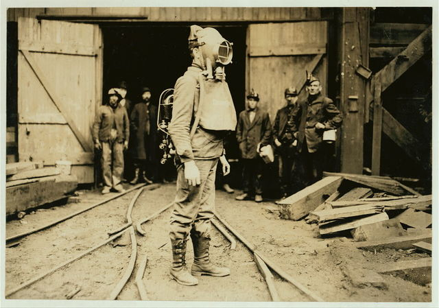 """""""First Aid to the Injured"""" man equipped with Draeger Oxygen Helmet. Avondale Shaft, D.L.W. Colliery. The need for and the presence of these rescue outfits is a strong argument against the employment of young boys.  Location: [Pennsylvania]"""