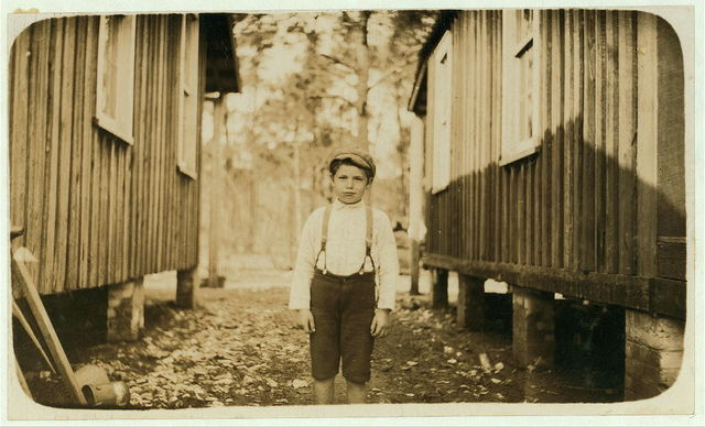 Frank Obin, eight years old. Shucks oysters at Pass Christian. I found him asleep on the floor of the shed at 4 o'clock one morning.  Location: Pass Christian, Mississippi.