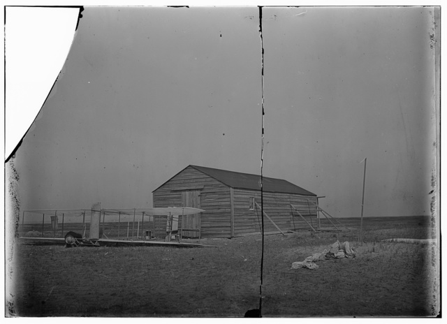 [Front view of glider in front of the camp building at Kitty Hawk, North Carolina]