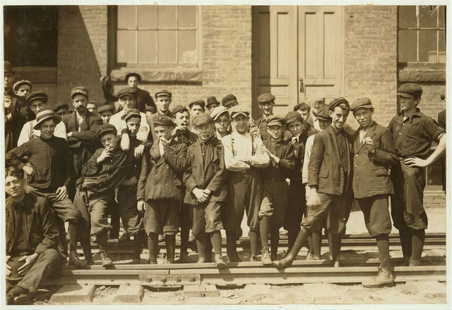 Group in front of Indian Mfg. Co. Everyone in photo was working.  Location: Indian Orchard, Massachusetts.