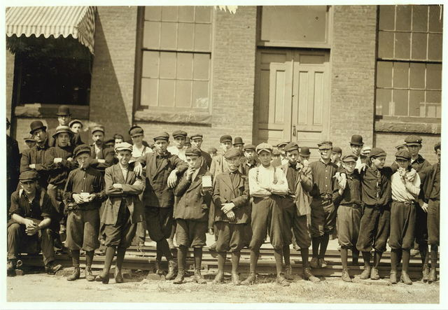 Group in front of Indian Orchard Mfg. Co. Everyone in photo was working. Boy not photographed. Hector Dubois, 24 Water St. Doffer in Indian Orchard; crushed finger in pump.  Location: Indian Orchard, Massachusetts.