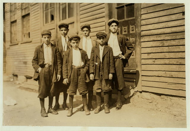 Group in which the two smallest are Camillo De Marco, 129 Common St., to right of picture (see 2470). Joseph Dangolo, to left of picture, 61 Common Street.  Location: Lawrence, Massachusetts.